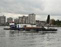 De Schelde met de duwboot Oranje Dordrecht.